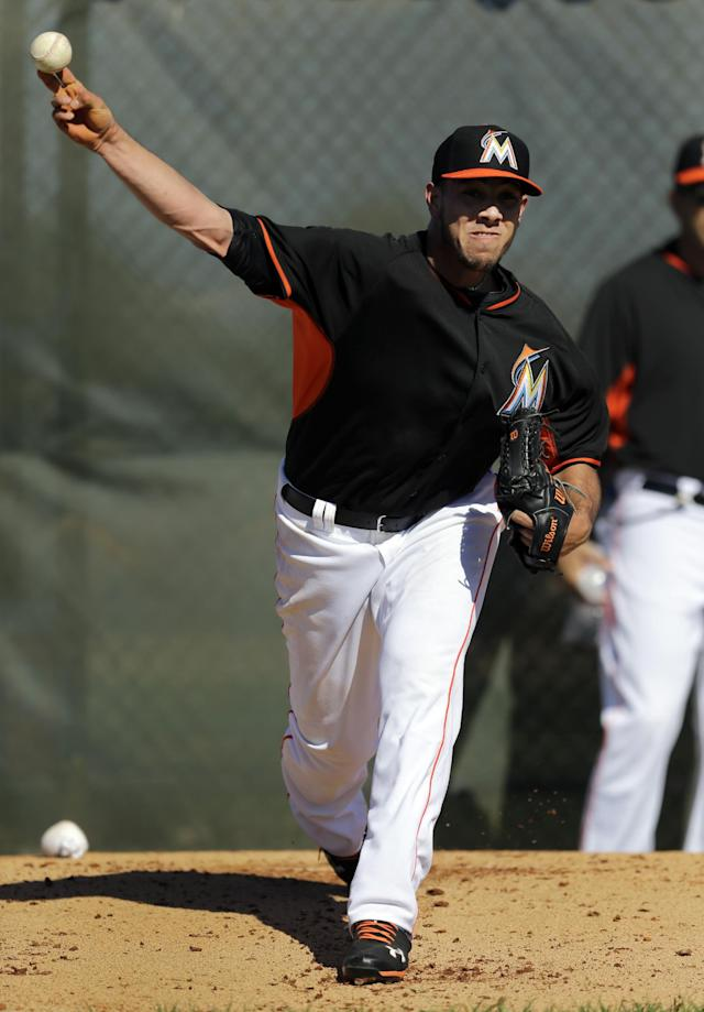Miami Marlins pitcher Jose Fernandez throws a bullpen session during spring training baseball practice on Sunday, Feb. 16, 2014, in Jupiter, Fla. (AP Photo/Jeff Roberson)