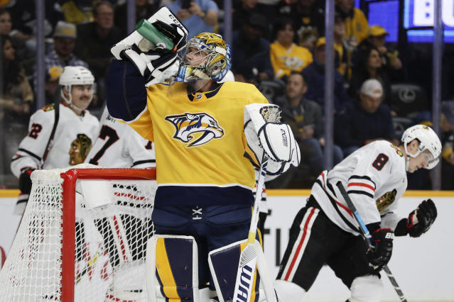 Nashville Predators goaltender Pekka Rinne (35), of Finland, takes a drink as Chicago Blackhawks left wing Dominik Kubalik (8), of the Czech Republic, skates away after scoring a goal in the first period of an NHL hockey game Saturday, Nov. 16, 2019, in Nashville, Tenn. (AP Photo/Mark Humphrey)