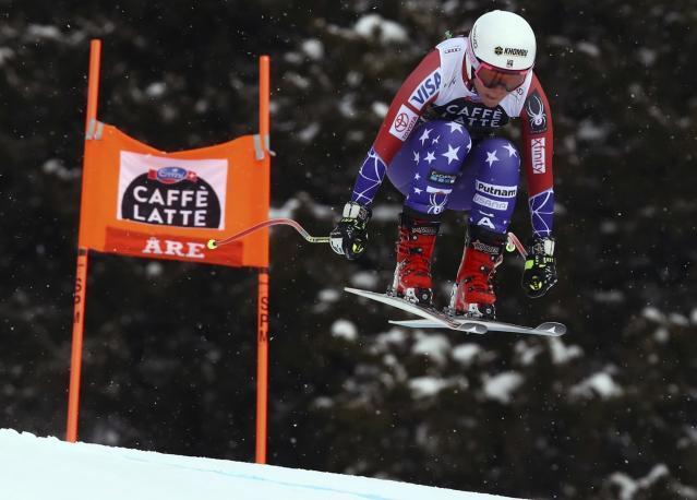 FILE - In this March 14, 2018, file photo United States' Breezy Johnson speeds down the course during a women's downhill, at the alpine ski World Cup finals in Are, Sweden. Johnson tore a ligament in her knee during a second straight offseason training session. (AP Photo/Alessandro Trovati, File)