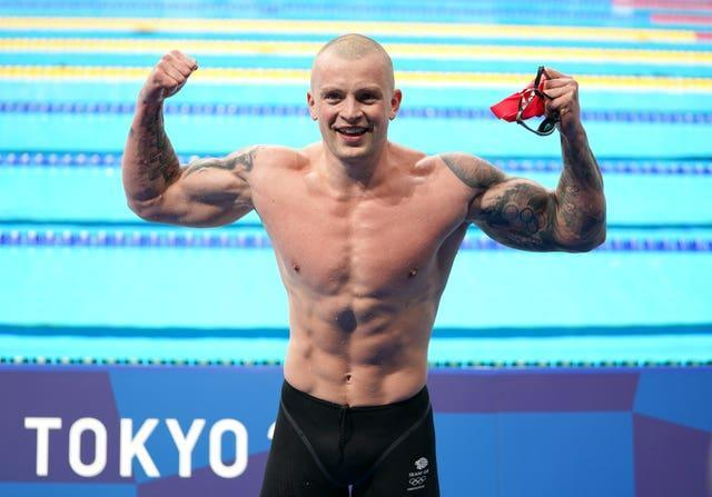 Adam Peaty reacts after his victory