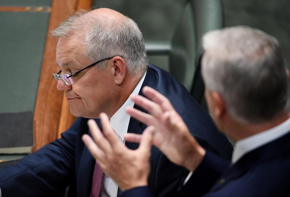 CANBERRA, AUSTRALIA - MARCH 03: Prime Minister Scott Morrison listens to Deputy Prime Miniser Michael McCormack during Question Time on March 03, 2020 in Canberra, Australia. The Reserve Bank has cut interest rates to 0.05% as the Federal Government works on plans to safeguard the Australian economy amid the current coronavirus outbreak. (Photo by Tracey Nearmy/Getty Images)