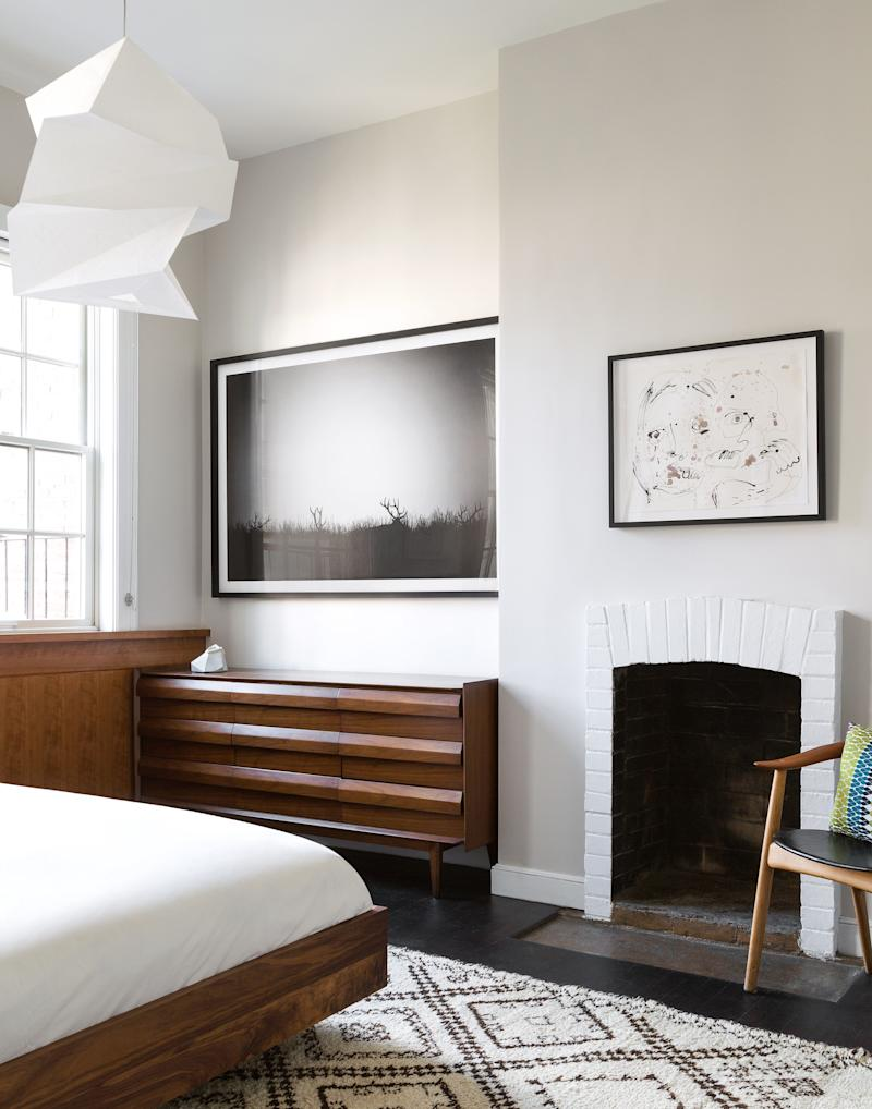 A Manhattan bedroom by Suchi Reddy of Reddymade Design is furnished with the essentials.