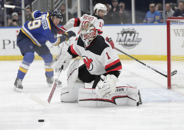 New Jersey Devils goaltender Keith Kinkaid (1) makes a save in the second period of an NHL hockey game against the St. Louis Blues, Tuesday, Feb. 12, 2019, in St. Louis. (AP Photo/Tom Gannam)