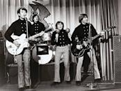 """<p>Developed as an American response to the Beatles, the quartet was chosen from more than 400 auditions to star in the TV series of the same name from 1966 to 1968. Only two in the group originally had musical experience, while the other two had been child stars. Anonymous studio musicians first backed the group, but they eventually pushed to play their own instruments on their third album. Numerous hits included <a href=""""https://www.amazon.com/Last-Train-To-Clarksville/dp/B00125SAEU/?tag=syn-yahoo-20&ascsubtag=%5Bartid%7C10055.g.33861456%5Bsrc%7Cyahoo-us"""" rel=""""nofollow noopener"""" target=""""_blank"""" data-ylk=""""slk:&quot;Last Train to Clarksville&quot;"""" class=""""link rapid-noclick-resp"""">""""Last Train to Clarksville"""" </a>(1966), """"<a href=""""https://www.amazon.com/Im-A-Believer/dp/B00125YYD6/?tag=syn-yahoo-20&ascsubtag=%5Bartid%7C10055.g.33861456%5Bsrc%7Cyahoo-us"""" rel=""""nofollow noopener"""" target=""""_blank"""" data-ylk=""""slk:I'm a Believer"""" class=""""link rapid-noclick-resp"""">I'm a Believer</a>"""" (1967), <a href=""""https://www.amazon.com/Daydream-Believer/dp/B00125WVGI/?tag=syn-yahoo-20&ascsubtag=%5Bartid%7C10055.g.33861456%5Bsrc%7Cyahoo-us"""" rel=""""nofollow noopener"""" target=""""_blank"""" data-ylk=""""slk:&quot;Daydream Believer&quot;"""" class=""""link rapid-noclick-resp"""">""""Daydream Believer"""" </a> (1967) and <a href=""""https://www.amazon.com/Im-Not-Your-Steppin-Stone/dp/B07WGHZ3QZ/?tag=syn-yahoo-20&ascsubtag=%5Bartid%7C10055.g.33861456%5Bsrc%7Cyahoo-us"""" rel=""""nofollow noopener"""" target=""""_blank"""" data-ylk=""""slk:&quot;I'm Not Your Stepping Stone&quot;"""" class=""""link rapid-noclick-resp"""">""""I'm Not Your Stepping Stone""""</a>(1967).</p>"""