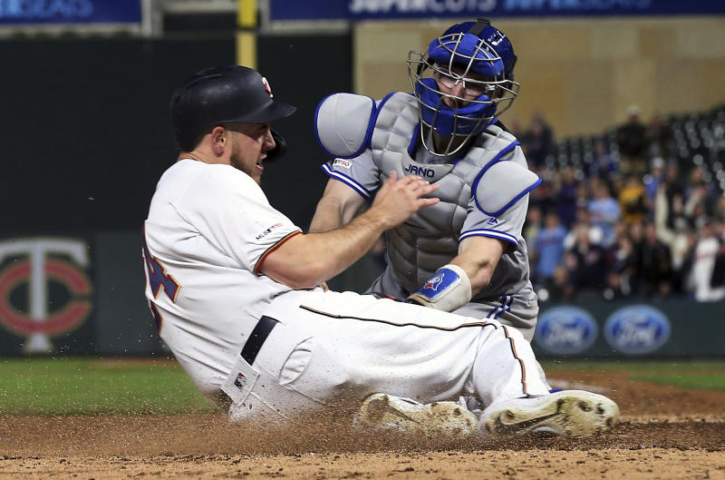 Minnesota Twins' C.J. Cron, left, is tagged out at the plate by Toronto Blue Jays catcher Danny Jansen for the final out to end the baseball game, Tuesday, April 16, 2019, in Minneapolis. The Blue Jays won 6-5. (AP Photo/Jim Mone)