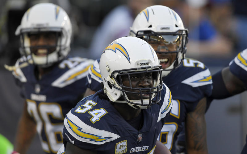 Los Angeles Chargers outside linebacker Melvin Ingram celebrates with teammates after a touchdown against the Bills. (AP)