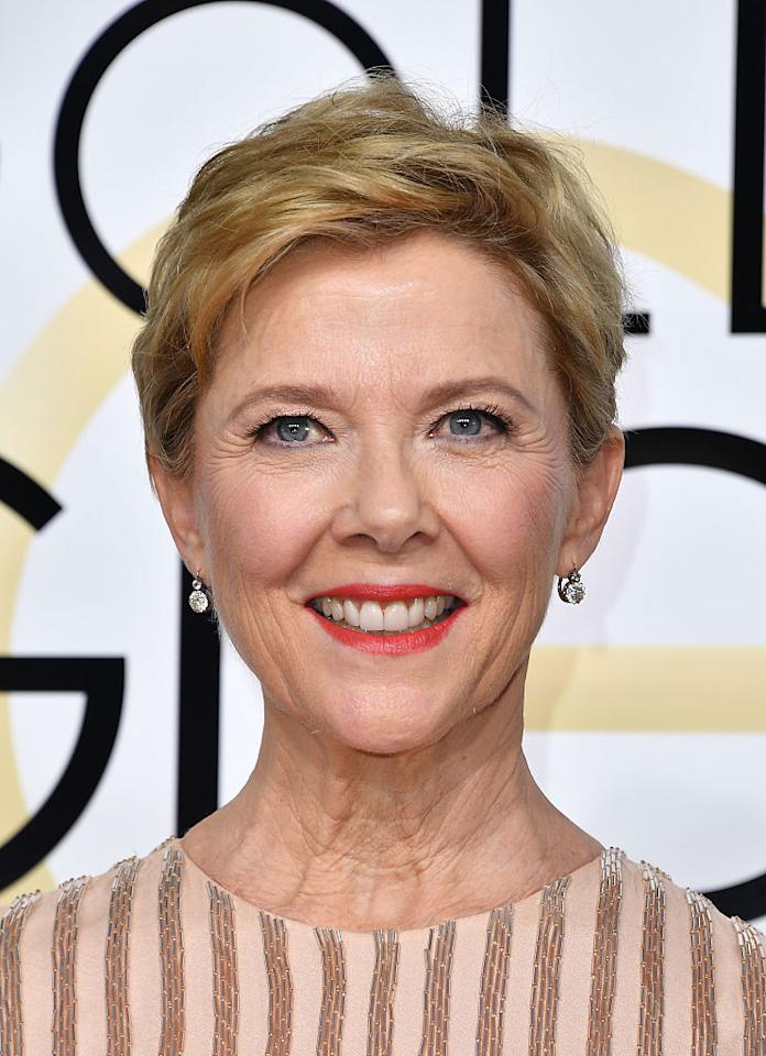 <p>Annette Bening's lip pick is a gorgeous coral spin on traditional red. (Photo: Getty Images) </p>