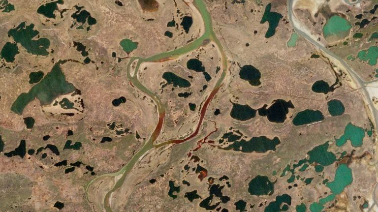An aerial view of the fuel spill in the Ambarnaya River in the Arctic