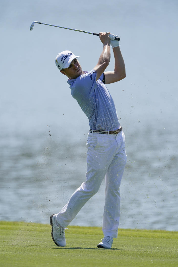 Justin Thomas hits from the fairway on the eighth hole during the final round of the Tour Championship golf tournament at East Lake Golf Club in Atlanta, Monday, Sept. 7, 2020. (AP Photo/John Bazemore)