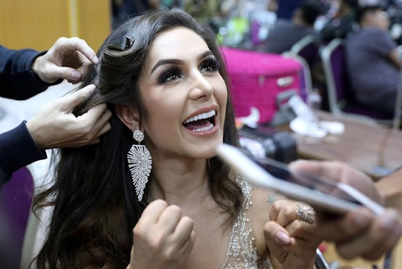 Contestant Izabele Coimbra of Brazil gets touchups on her hair.