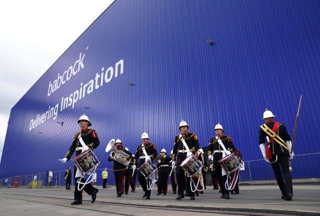 The Royal Marine Band leave The Venturer Building after a frigate steel cutting ceremony for the first of the class Type 31 frigate, at Babcock Rosyth, Fife