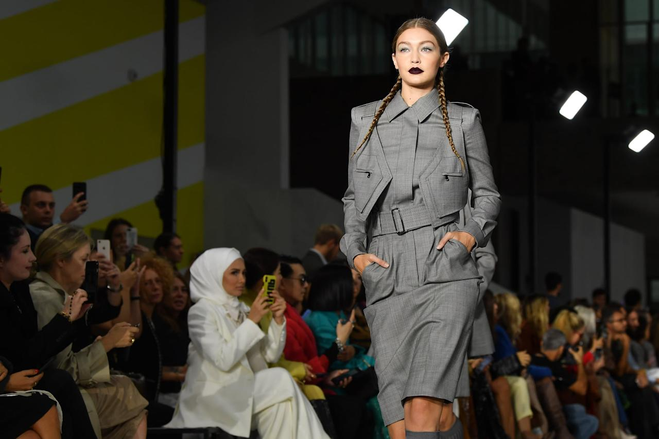 <p>At Max Mara, Gigi led the charge in a gray belted look.</p>