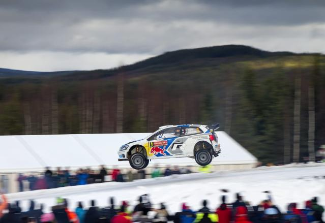 Sebastien Ogier and co-pilot Julien Ingrassia, both of France, jump the Colin's Crest in their VW Polo WRC during Rally Sweden in Hagfors February 8, 2014. Ogier broke the jump record of the Colin's Crest, named after late WRC champion Colin McRae, covering a distance of 41 metres (134 feet), according to motorsports media. REUTERS/Micke Fransson/TT News Agency (SWEDEN - Tags: SPORT MOTORSPORT TPX IMAGES OF THE DAY) NO COMMERCIAL OR BOOK SALES. SWEDEN OUT. NO COMMERCIAL OR EDITORIAL SALES IN SWEDEN