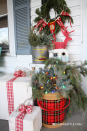 """<p>A thoughtfully curated selection of vintage finds adds a homey, charming appeal to a Christmas porch — not to mention a bit of a retro ski lodge vibe. And when you use one-of-a-kind items, your porch is guaranteed to have a conversation-starting look unique to you.<br></p><p><strong><em>Get the look at <a href=""""https://robbrestyle.com/eclectic-holiday-home-tour/"""" rel=""""nofollow noopener"""" target=""""_blank"""" data-ylk=""""slk:Robb Restyle"""" class=""""link rapid-noclick-resp"""">Robb Restyle</a>.</em></strong> </p>"""