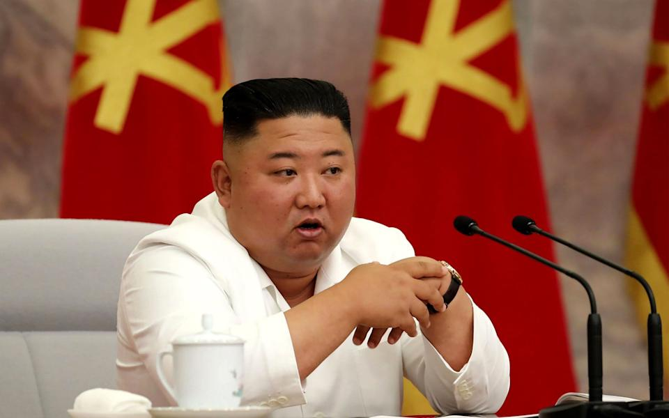 North Korean leader Kim Jong Un speaks during the Political Bureau of the Central Committee of the Workers' Party of Korea (WPK) meeting in Pyongyang. - STR/AFP