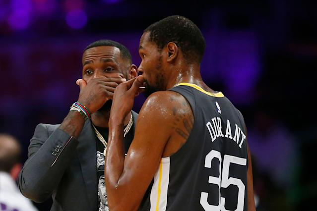 LeBron James and Kevin Durant chat Thursday night. (Getty Images)