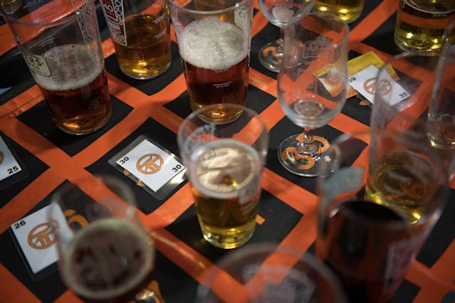 <p>Half finished glasses are placed on squares in return for tickets by visitors leaving the building to smoke cigarettes at the CAMRA (Campaign for Real Ale) Great British Beer festival at Olympia exhibitioncenter on August 8, 2017 in London, England. (Photo: Carl Court/Getty Images) </p>