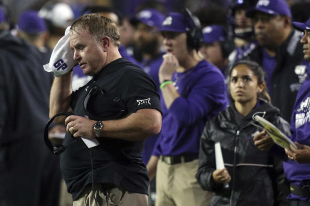 TCU head coach Gary Patterson wipes his face with a towel in the fourth quarter against West Virginia in an NCAA college football game Friday, Nov. 29, 2019, in Fort Worth, Texas. (AP Photo/Richard W. Rodriguez)