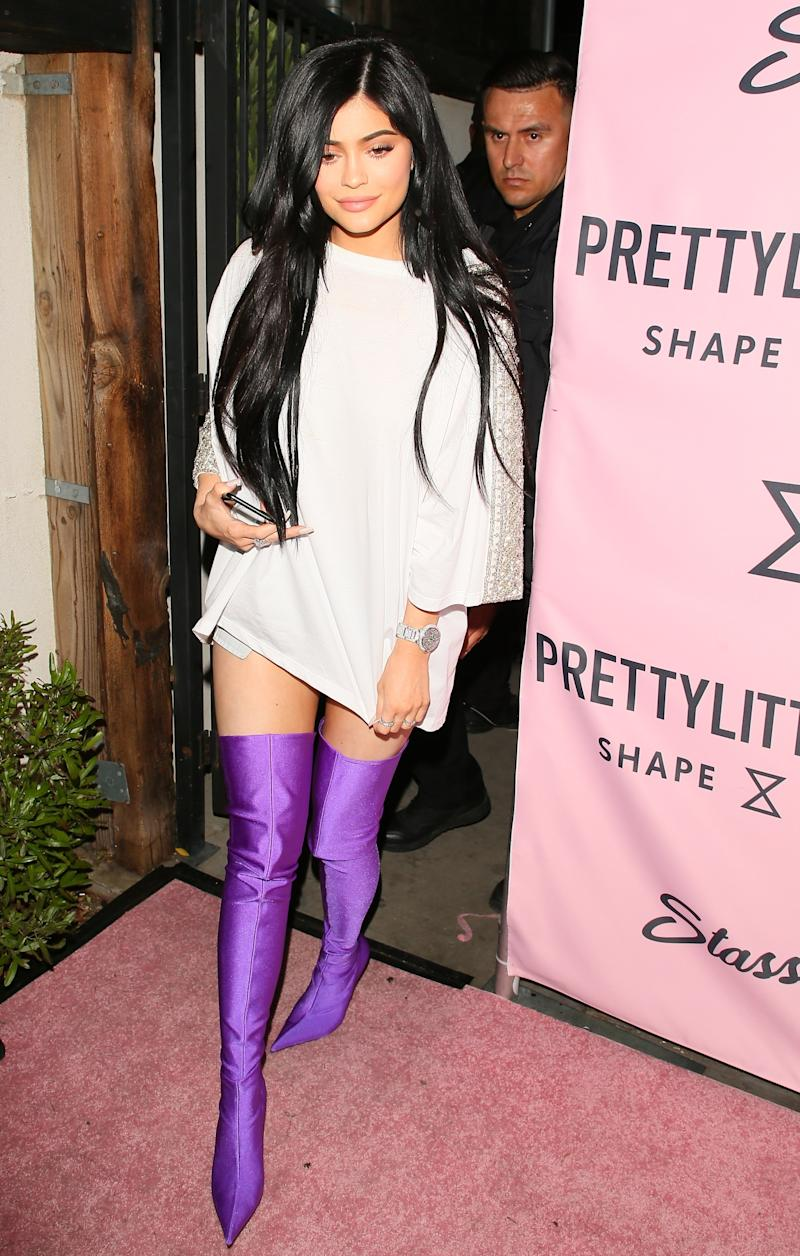 Just prior to Coachella this weekend, Jenner continued to make the biggest statements, foregoing the usual fringe-and-floral festival look in favor of purple Balenciaga boots at the PrettyLittleThing launch in Los Angeles, California, April 2017.