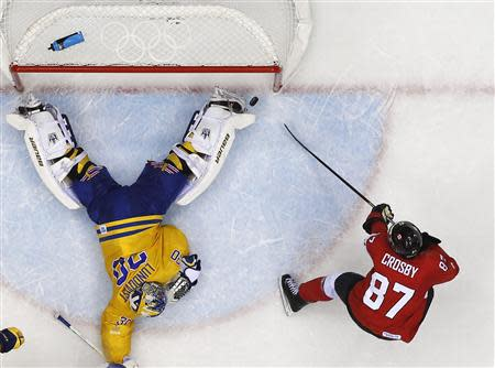 Canada's Sidney Crosby (R) scores past Sweden's goalie Henrik Lundqvist on a breakaway during the second period of their men's ice hockey gold medal game at the Sochi 2014 Winter Olympic Games February 23, 2014. REUTERS/Mark Blinch