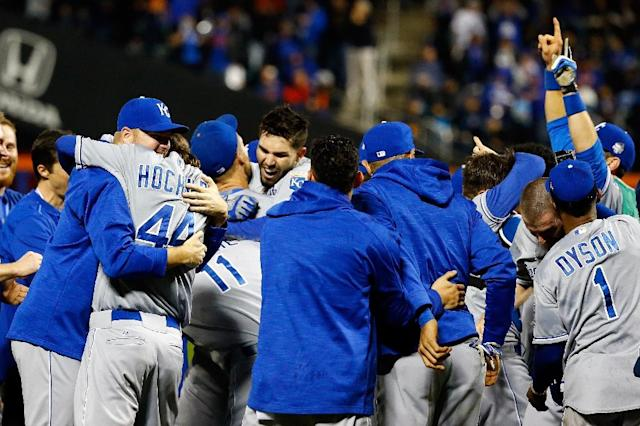 Kansas City Royals' Eric Hosmer celebrates with teammates after they defeat the New York Mets in Game Five of the 2015 World Series at Citi Field on November 1, 2015 (AFP Photo/Al Bello)