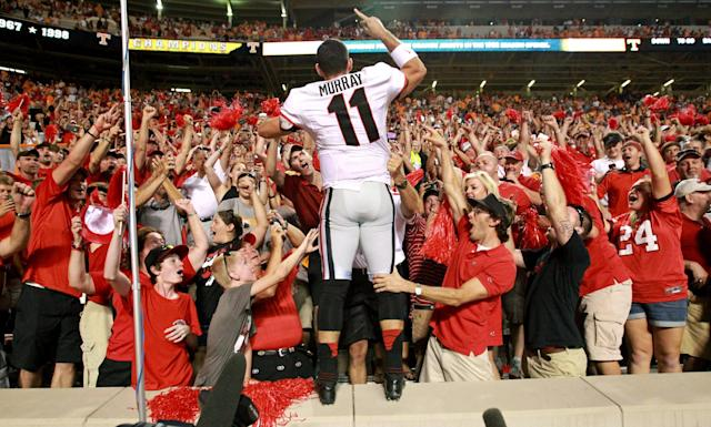 Georgia quarterback Aaron Murray (11) celebrates with fans after Georgia won 34-31 over Tennessee during an NCAA college football game in Knoxville, Tenn., Oct. 5, 2013. (AP Photo/Atlanta Journal-Constitution, Jason Getz)