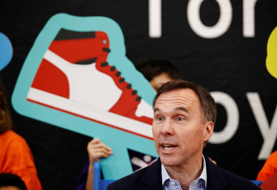 Canada's Finance Minister Bill Morneau speaks after he tried on a new pair of shoes during a pre-budget photo opportunity with children in Toronto, Ontario, Canada, March 14, 2019.  REUTERS/Mark Blinch