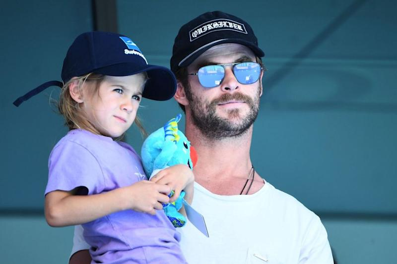 Actor Chris Hemsworth and daughter India Rose Hemsworth attend the swimming on day three of the Gold Coast 2018 Commonwealth Games at Optus Aquatic Centre on April 7, 2018 on the Gold Coast, Australia. Source: Getty