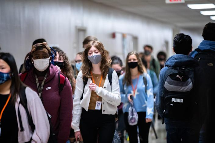 Students at Mauldin High School walk through the hallways between class periods Jan. 19, the first day back under their updated COVID-19 attendance plan, in Mauldin, S.C.