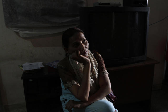<p>Bindiya Rana, a transgender candidate in Pakistan's elections, listens to voters during a campaign in Karachi, Pakistan, April 15, 2013. (AP Photo/Shakil Adil) </p>