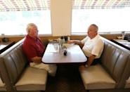 Gerald Poor (R) talks with long time friend Larry Terrell at a cafe in Muncie Indiana, U.S., August 13, 2016. REUTERS/Chris Bergin