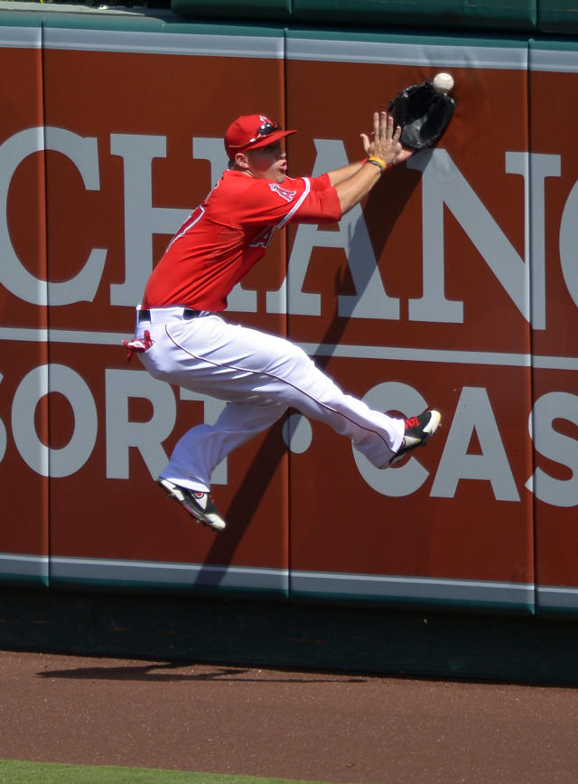 Los Angeles Angels center fielder Mike Trout cannot get to a ball hit for a double by Seattle Mariners' Kendrys Morales during the second inning of a baseball game on Sunday, Sept. 22, 2013, in Anaheim, Calif. (AP Photo/Mark J. Terrill)