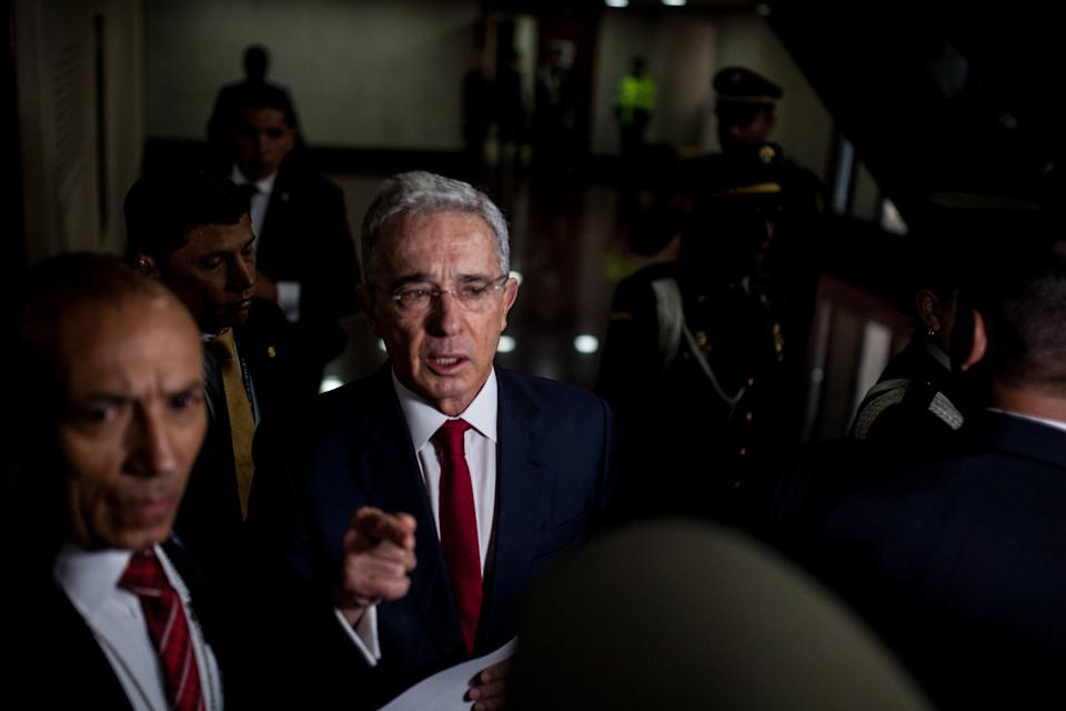 BOGOTA - COLOMBIA, OCTOBER 08: Former Colombian president, Alvaro Uribe speaks as he arrives to the Supreme Court to face a historical judicial investigation over alleged witness tampering in Bogota, Colombia on October 08, 2019. In a landmark case that has deeply polarized Colombia, former president Álvaro Uribe will testify before the Supreme Court on October 8, marking the first time that a former president will appear before the court in an investigation that could eventually result in him facing criminal charges. The investigation has serious implications for the independence of Colombias justice institutions, as well as the ongoing efforts to uncover the full truth about the powerful political networks that backed paramilitary death squads during Colombias decades-long conflict. (Photo by Juancho Torres/Anadolu Agency via Getty Images)