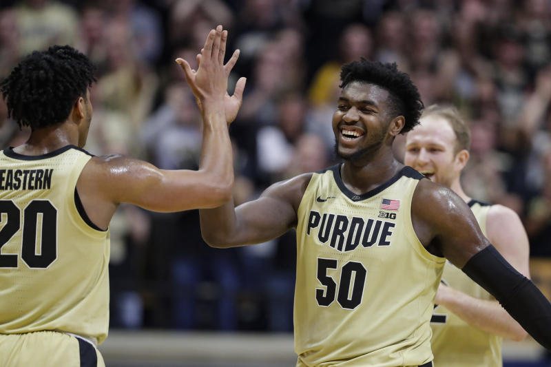 Purdue forward Trevion Williams (50) celebrates with guard Nojel Eastern (20) during the second half of an NCAA college basketball game against Michigan State in West Lafayette, Ind., Sunday, Jan. 12, 2020. (AP Photo/Michael Conroy)