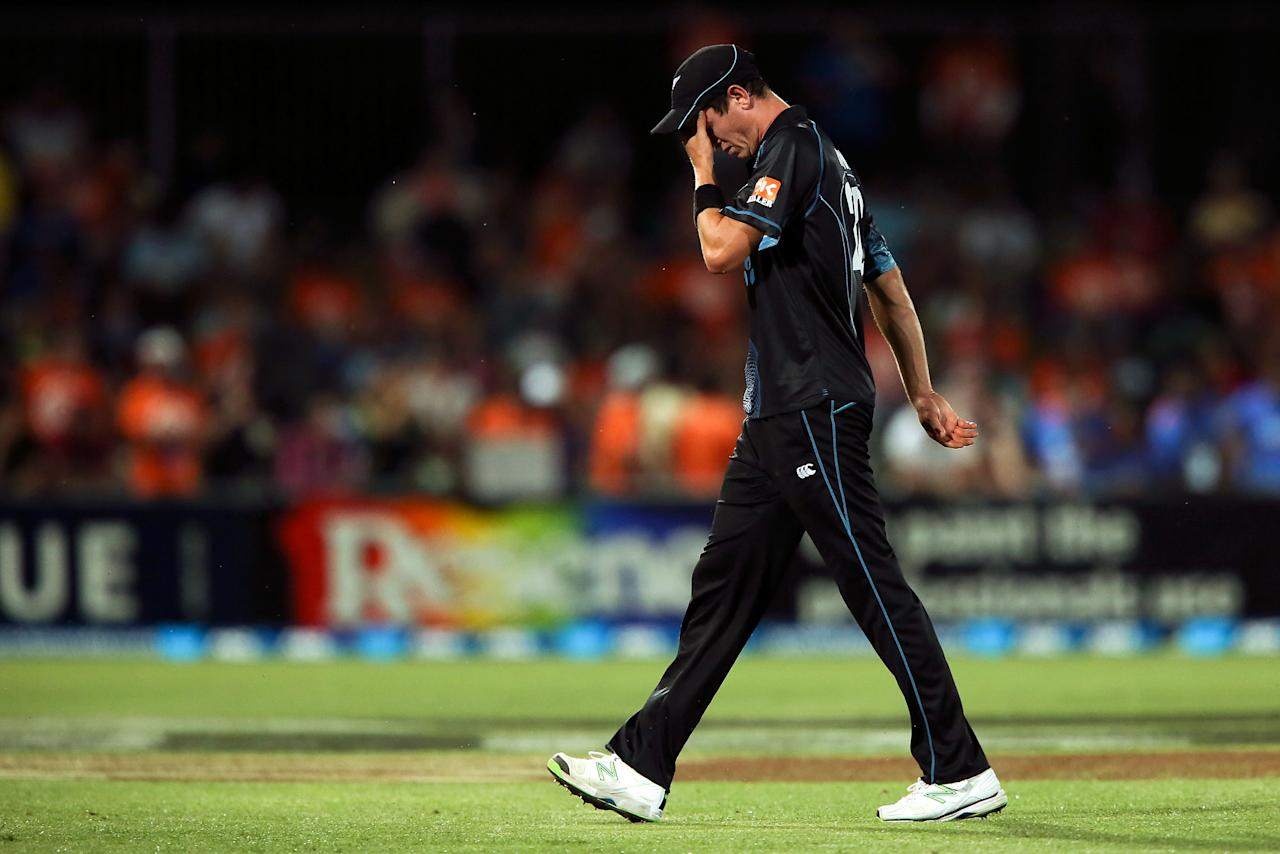NAPIER, NEW ZEALAND - JANUARY 19:  Adam Milne of New Zealand leaves the field midway through bowling an over during the first One Day International match between New Zealand and India at McLean Park on January 19, 2014 in Napier, New Zealand.  (Photo by Hagen Hopkins/Getty Images)