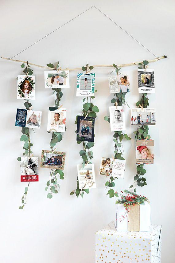 """<p>It's just not the holidays without a garland. </p><p>Get the tutorial at <a href=""""https://go.redirectingat.com?id=74968X1596630&url=https%3A%2F%2Fwww.minted.com%2Fjulep%2F2016%2F12%2F06%2Fdiy-eucalyptus-garland-christmas-card-display%2F&sref=https%3A%2F%2Fwww.housebeautiful.com%2Fentertaining%2Fholidays-celebrations%2Fg22691991%2Fdiy-christmas-card-holders%2F"""" rel=""""nofollow noopener"""" target=""""_blank"""" data-ylk=""""slk:Alice & Lois"""" class=""""link rapid-noclick-resp"""">Alice & Lois</a>.</p>"""