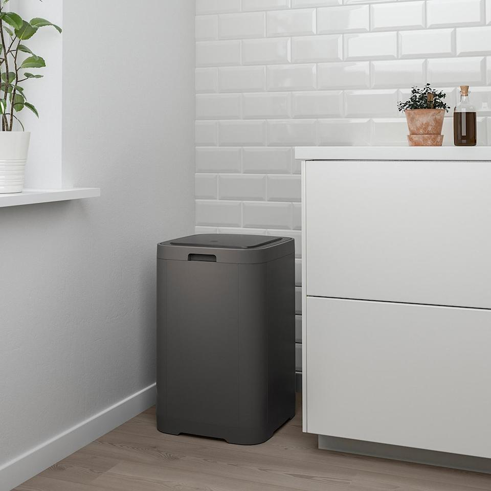 """<p>Leave it to IKEA to create a minimalist-minded trash receptacle that doesn't cost an arm and a leg. This clean-lined option <a href=""""https://www.marthastewart.com/1510601/guide-serious-deep-cleaning-kitchen"""" rel=""""nofollow noopener"""" target=""""_blank"""" data-ylk=""""slk:opens with a light press"""" class=""""link rapid-noclick-resp"""">opens with a light press</a> of the lid and is designed with a compact square shape that you won't mind showing off in plain sight.</p> <p><strong><em>Shop Now: </em></strong><em>IKEA GIGANTISK Touch Top Trash Can, $29.99, </em><a href=""""https://www.ikea.com/us/en/p/gigantisk-touch-top-trash-can-dark-gray-20314071/"""" rel=""""nofollow noopener"""" target=""""_blank"""" data-ylk=""""slk:ikea.com"""" class=""""link rapid-noclick-resp""""><em>ikea.com</em></a><em>.</em></p>"""
