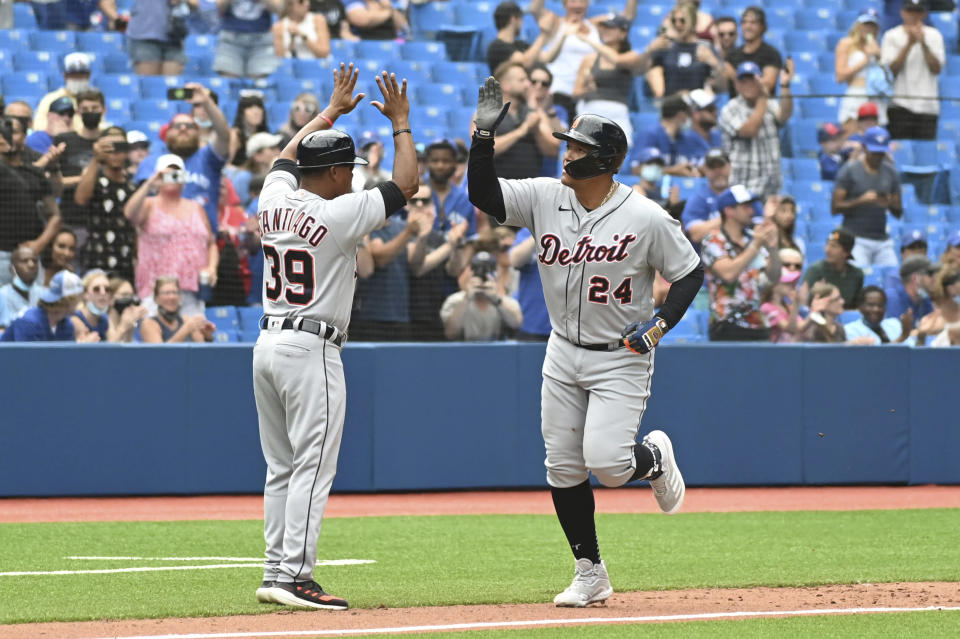 Detroit Tigers' Miguel Cabrera, right, rounds the bases after hitting his 500th career home run in the sixth inning against the Toronto Blue Jays during a baseball game in Toronto, Sunday, Aug. 22, 2021. (Jon Blacker/The Canadian Press via AP)