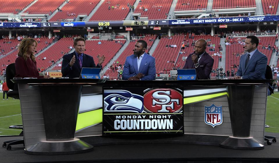 Nov 11, 2019; Santa Clara, CA, USA; ESPN Monday Night Football Countdown hosts (from left) Suzy Kolber, Steve Young, Randy Moss, Louis Riddick and Adam Schefter on the set before the game between the San Francisco 49ers and the Seattle Seahawks at Levi's Stadium. Mandatory Credit: Kirby Lee-USA TODAY Sports
