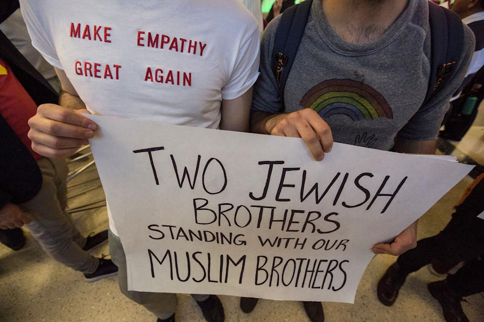 Brothers Adam, left, and Noah Reich show their support if immigrants as they join opponents of Donald Trump's new immigration order at the Tom Bradley International Terminal at LAX on January 29, 2017 in Los Angeles, California.