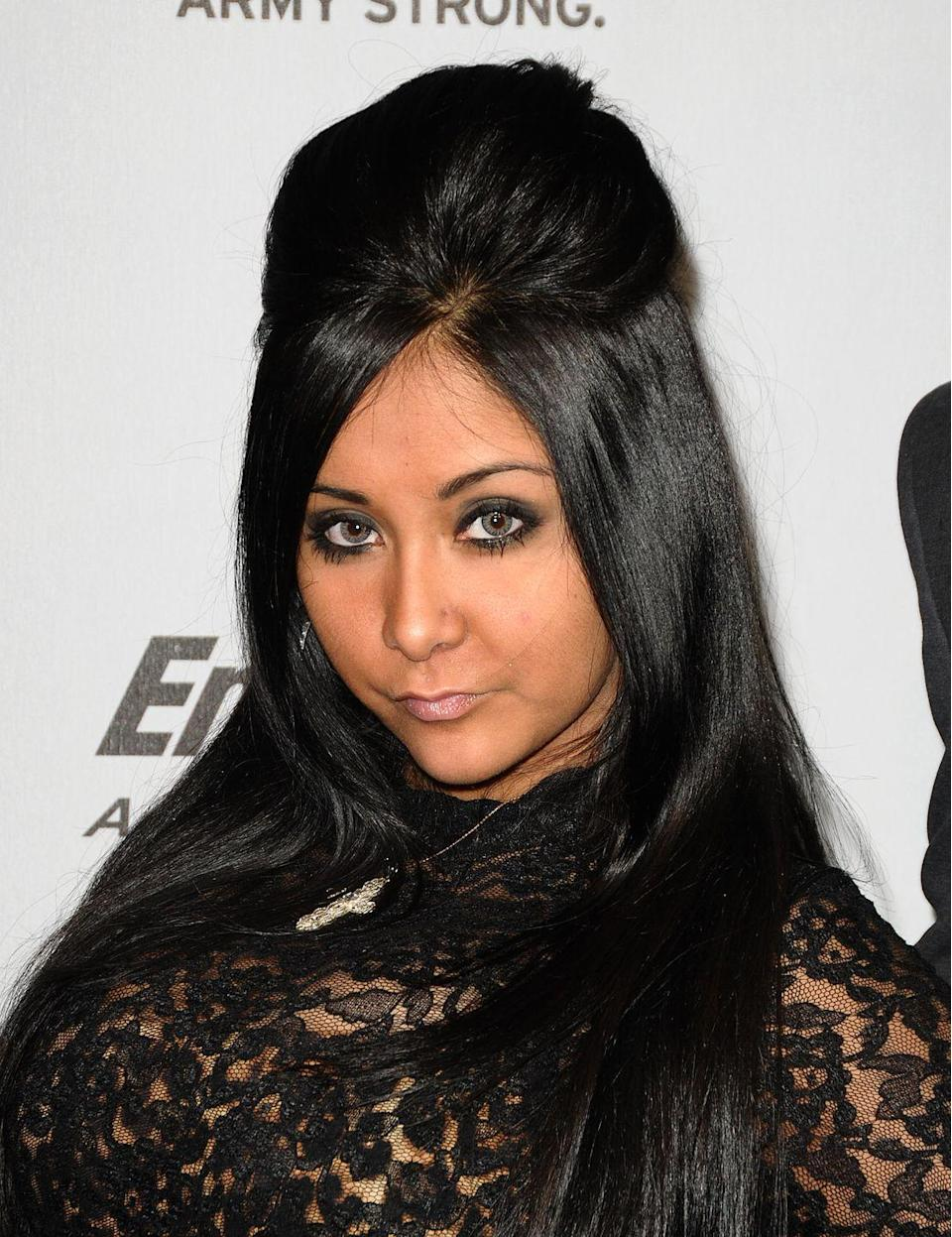 <p>Remember Bumpits? Yeah, us too. Thanks in part to <em>Jersey Shore,</em> this voluminous, pulled back look became a staple.</p>