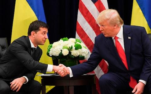 Ukrainian President Volodymyr Zelenskiy, left, meets Donald Trump in New York in September at the United Nations - Credit: SAUL LOEB / AFP