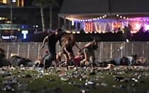 <p>Music fans take cover on the ground as others run for the nearest safe spot during the terrifying ordeal. </p>