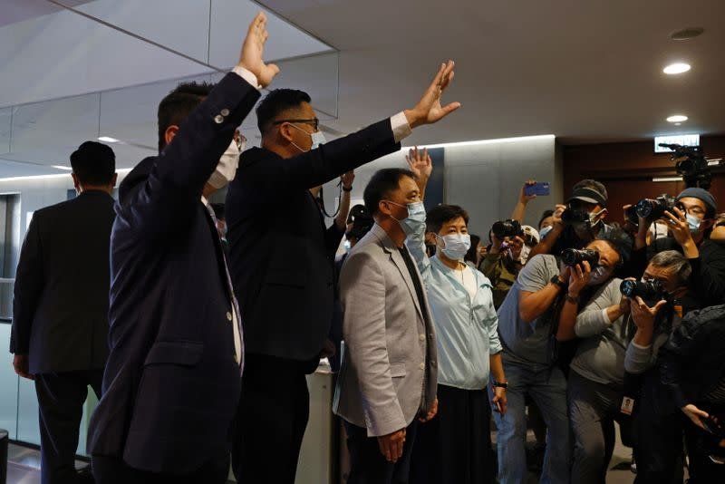 Pro-democracy legislators Helena Wong, Wu Chi-wai, Andrew Wan and Lam Cheuk-ting wave to media after handing in their resignation letters in Hong Kong