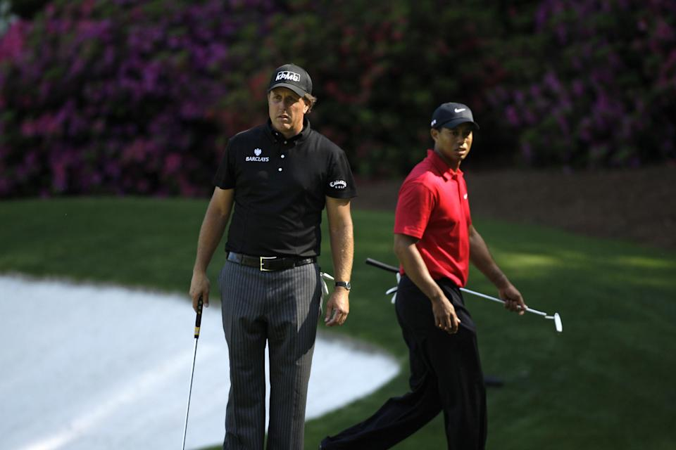 <p>Phil Mickelson and Tiger Woods during the final round of the Masters golf tournament at the Augusta National Golf Club in Augusta, Ga., Sunday, April 12, 2009. (AP Photo/Chris O'Meara) </p>