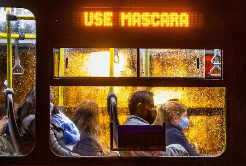 Commuters wearing face masks travel on a public bus n Curitiba, Brazil (AFP via Getty Images)