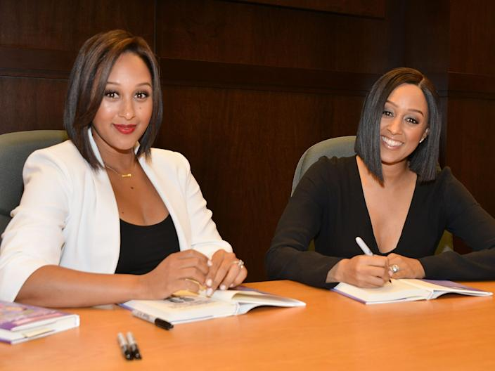 "Tamera (left) and Tia Mowry sign their book ""Twintuition"" at Barnes & Noble in Los Angeles."