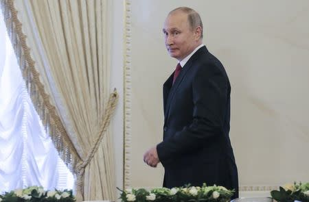 Russian President Putin attends a meeting with representatives of international news agencies in St. Petersburg