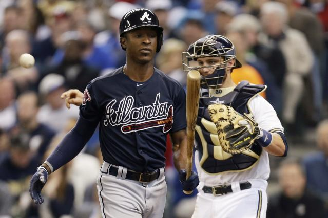 MILWAUKEE, WI - MARCH 31: B.J. Upton #2 of the Atlanta Braves walks to the dugout after striking out in the top of the third inning against the Milwaukee Brewers during Opening Day at Miller Park on March 31, 2014 in Milwaukee, Wisconsin. (Photo by Mike McGinnis/Getty Images)