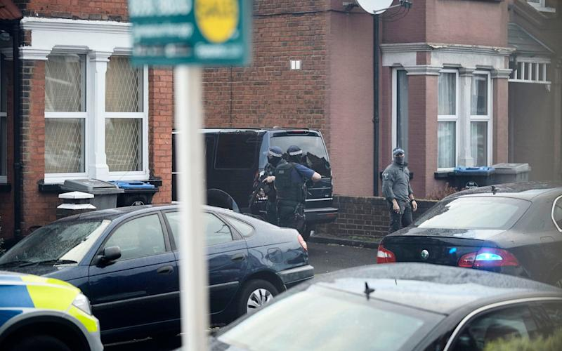 Police outside the terraced house in Willesden - Credit: Eyevine